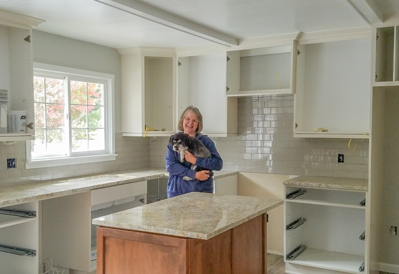 Homeowner and puppy during kitchen update, Golden Rule Remodeling & Design, Silverton Oregon